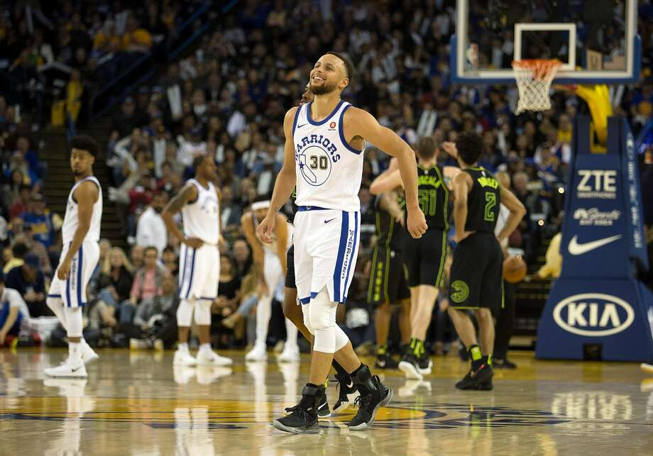 cdc681e69355 Golden State Warriors center Stephen Curry (30) limps off the court after  sustaining an