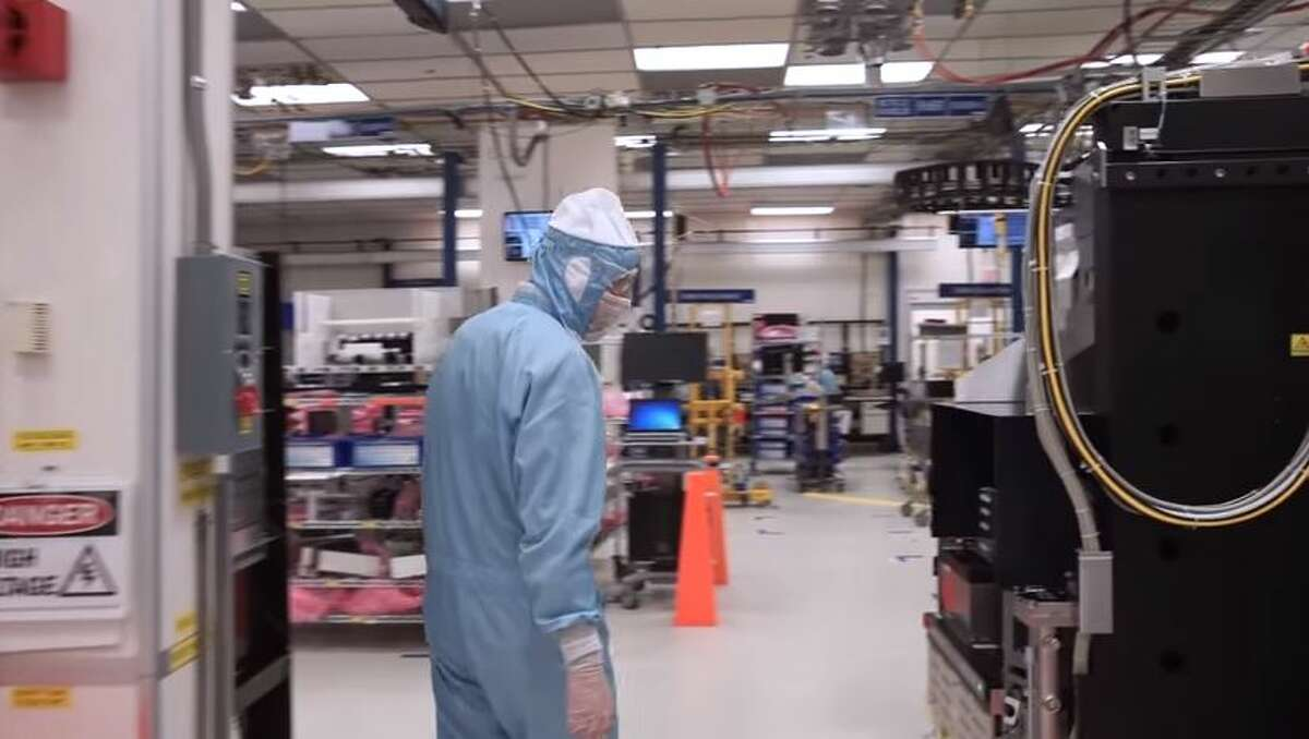 A worker inside ASML's manufacturing clean room in Wilton, Conn. ASML is expanding its operations as chip makers like GlobalFoundries adopt its extreme ultraviolet lithography equipment.