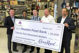 At Spec's main location on Smith Street, a check for $25,000 was presented to the Houston Food Bank. (L to R) are Gary Dukesherer, Diageo; Yolanda Alexander, Houston Food Bank; Sean Crowl, Houston Food Bank; John Rydman, Spec's Wines, Spirits & Finer Foods; and Jon Tepper of Diageo.
