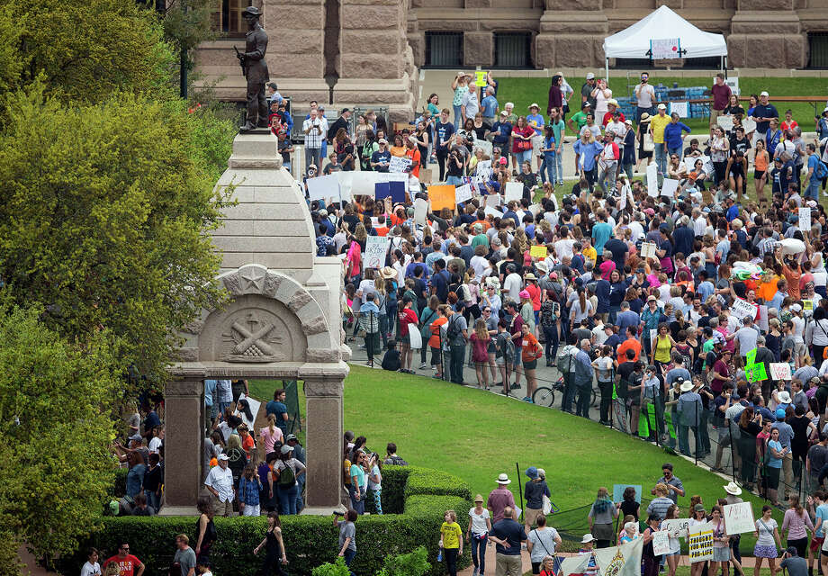 "Thousands of people gather on the grounds of the Texas State Capitol during a ""March for Our Lives"" rally in Austin, Texas, on Saturday, March 24, 2018. Photo: Nick Wagner, Associated Press / Austin American-Statesman"
