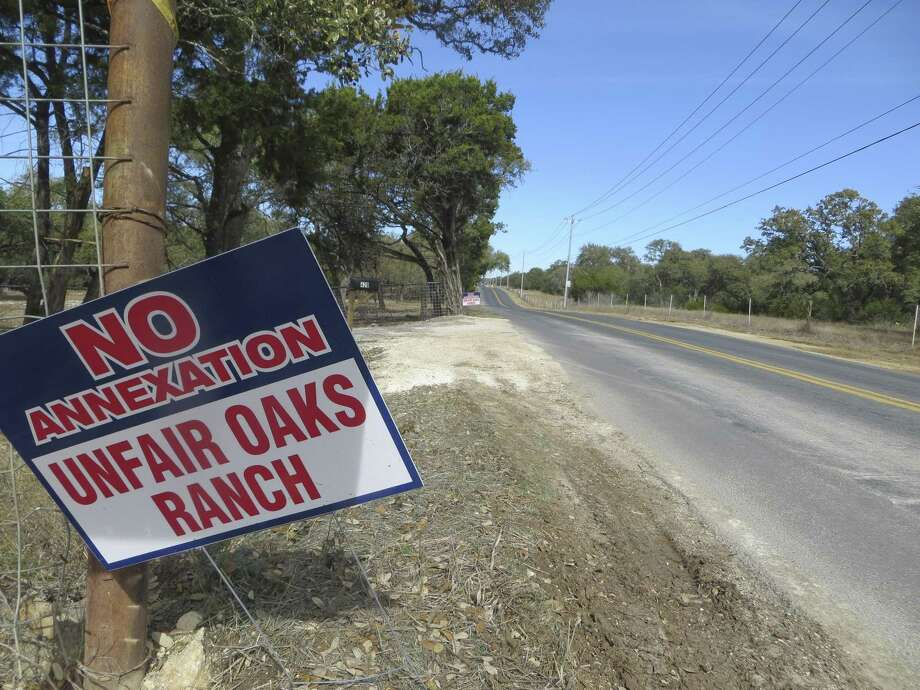 More than four months after the city of Fair Oaks Ranch annexed 1,312 acres in late 2017, some opponents of being brought into the city are still displaying signs in opposition along local roads. A lawsuit challenging the legality of the annexations is pending in Bexar County. Photo: Zeke MacCormack, San Antonio Express-News