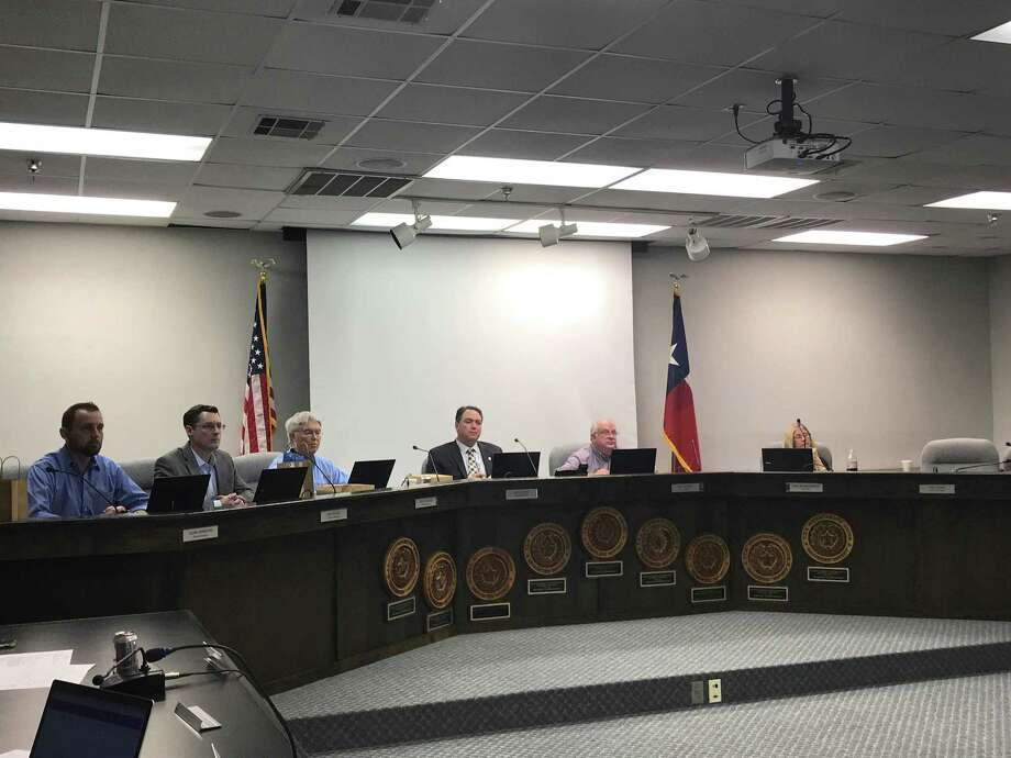 File Photo--Montgomery ISD school board during the February monthly meeting. On Tuesday's meeting for March, the board approved limited open enrollment for some campuses. Photo: Meagan Ellsworth