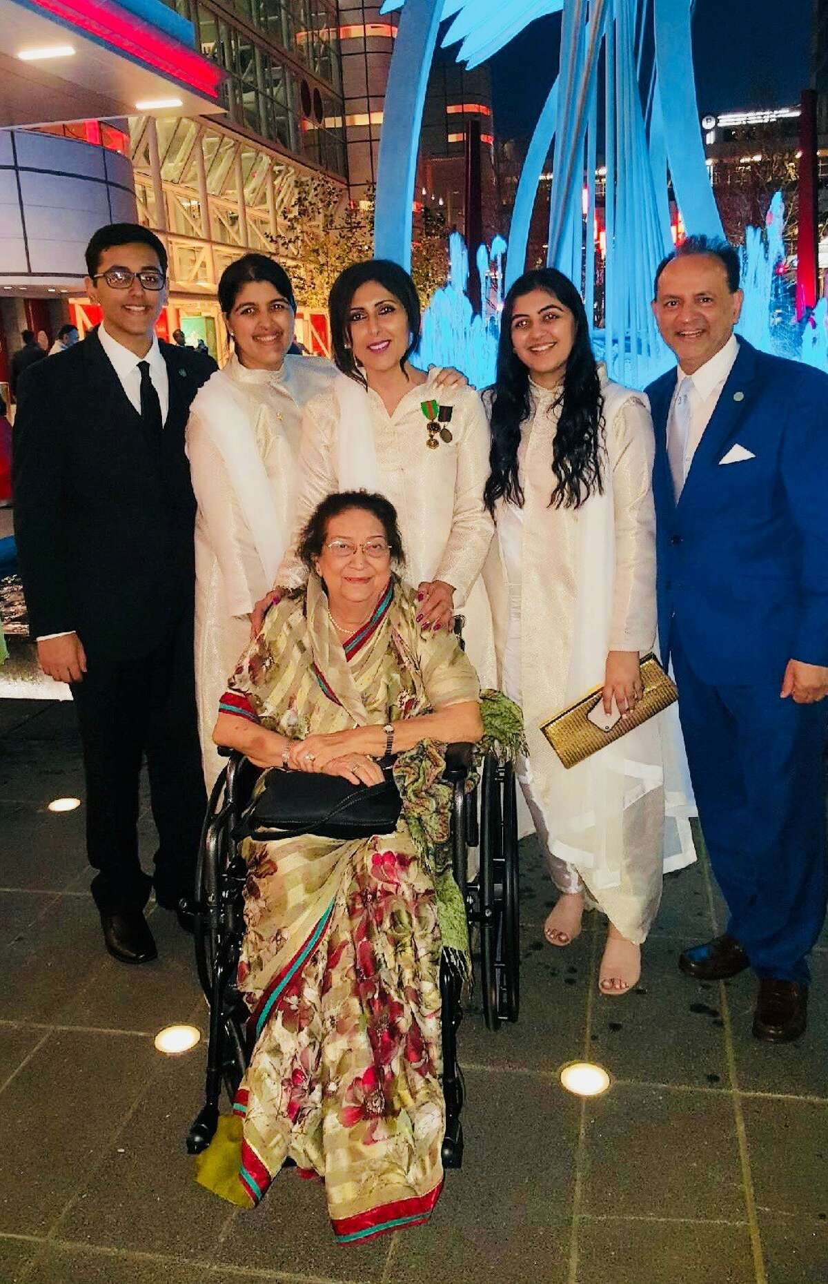 Yasmin Thawerbhory, center, attends the celebration marking the Aga Khan's 60th year as spiritual leader of the Ismaili Muslims.