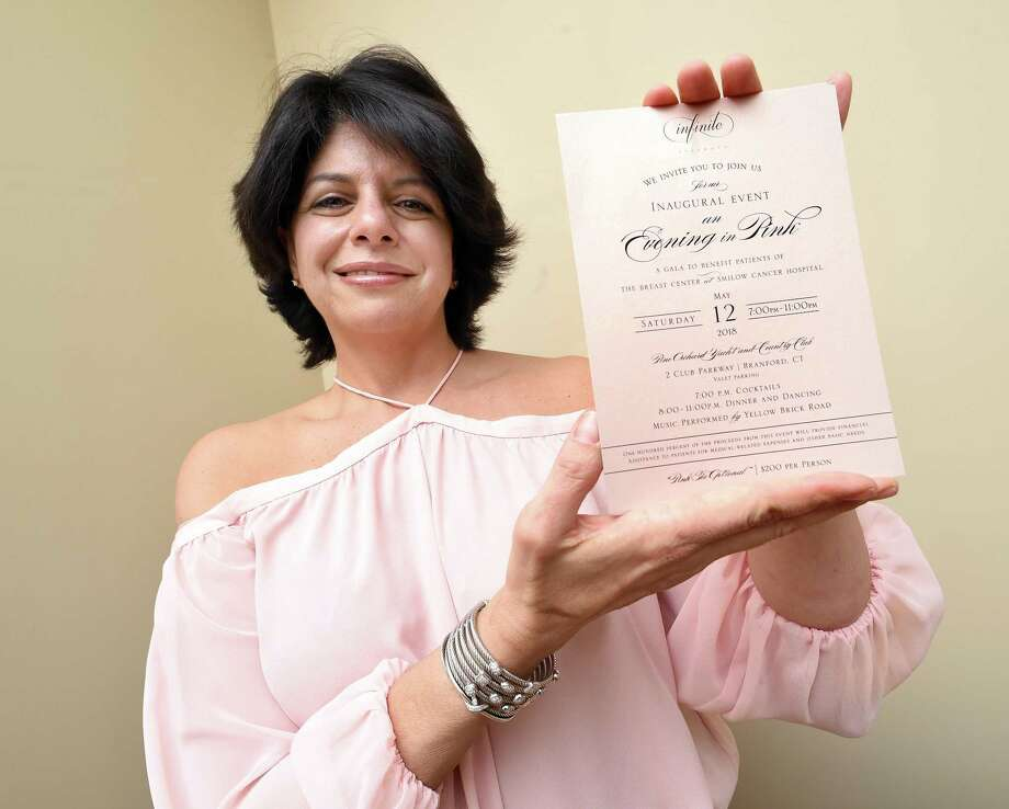 Roberta Lombardi, of Madison, displays an invitation for the Evening in Pink, a fundraiser for breast cancer patients at Smilow Cancer Hospital, on March 16, 2018. Photo: Arnold Gold / Hearst Connecticut Media / New Haven Register