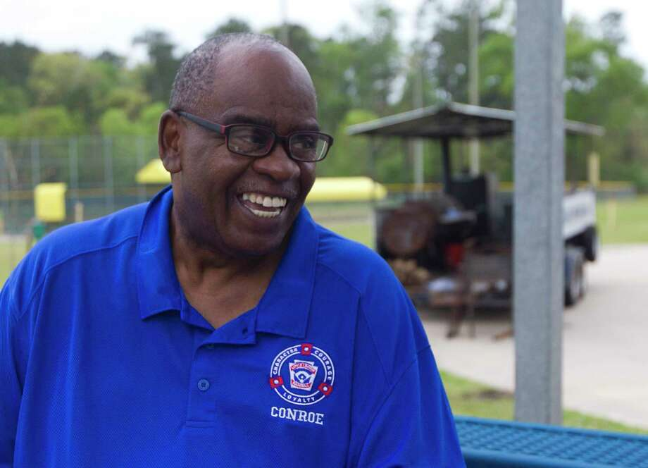 Roosevelt Lasker, president of Conroe Little League, shares a laugh before opening day, Saturday, March, 24, 2018, in Conroe. Lasker, who retiered March 22 after 37 years with the Conroe Police Department, is one of the original founders of the league. Photo: Jason Fochtman, Staff Photographer / © 2018 Houston Chronicle