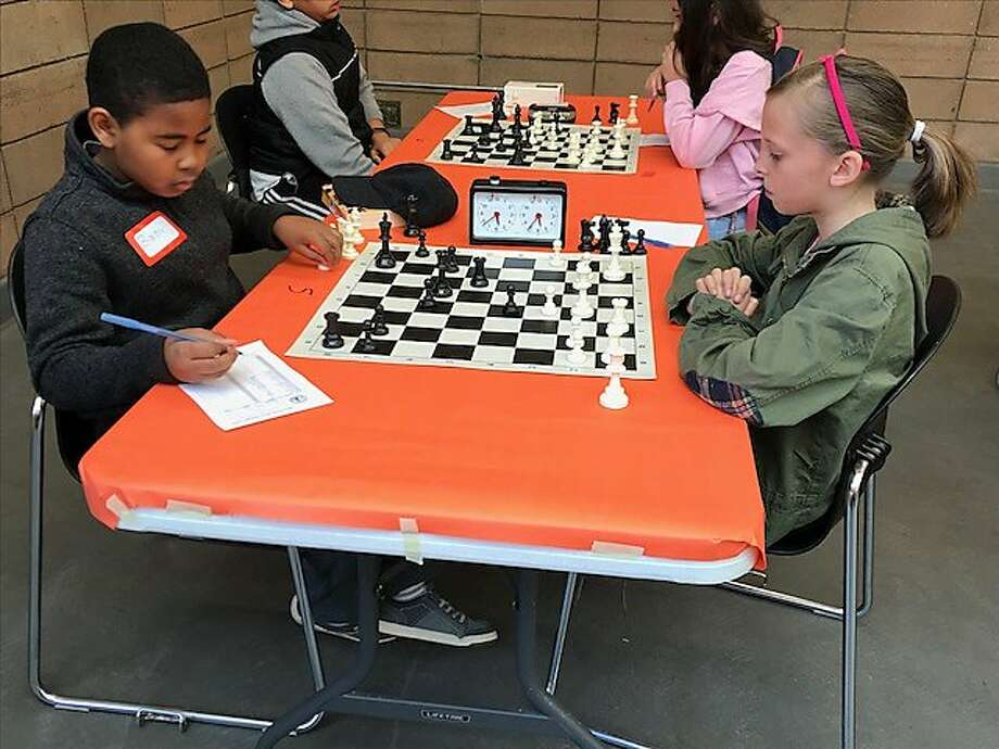 Baron Edwards, 11, and Tallulah McCarty-Snead, 9, were among more than 100 students K-12 from San Francisco and beyond who participated in the free chess championship sponsored by the Mechanics Institute. Photo: Karen De Sa / San Francisco Chronicle