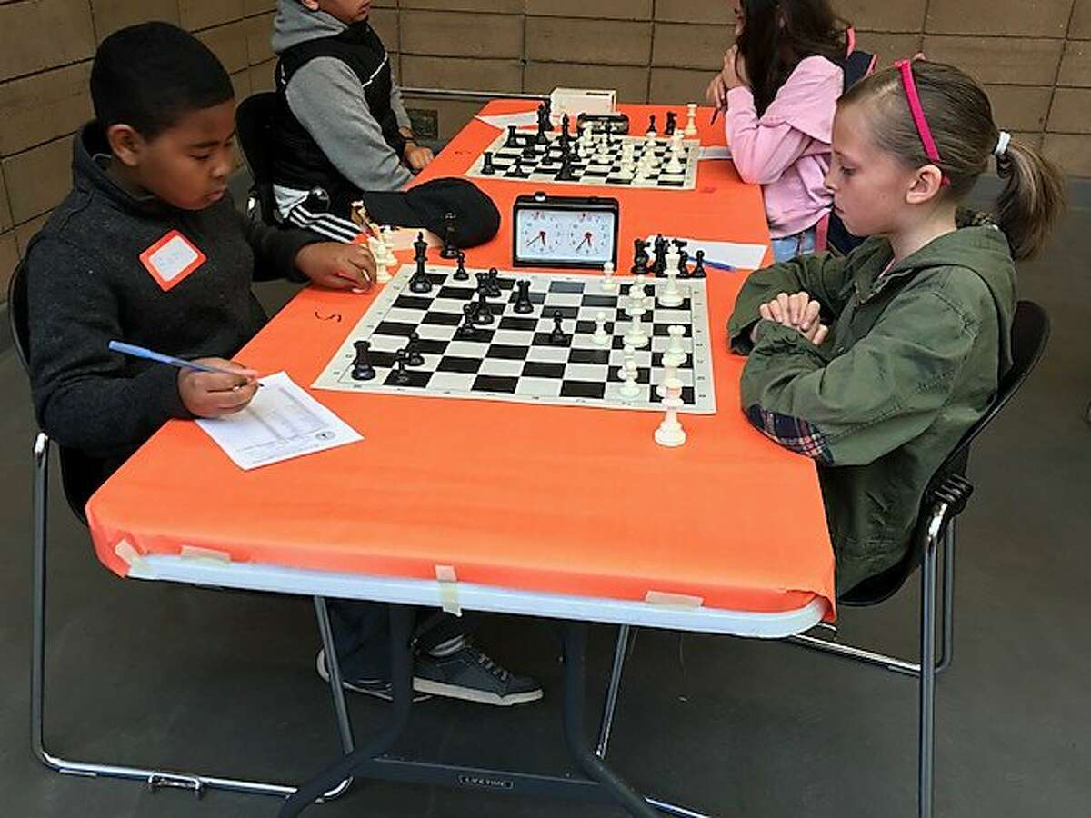 Baron Edwards, 11, and Tallulah McCarty-Snead, 9, were among more than 100 students K-12 from San Francisco and beyond who participated in the free chess championship sponsored by the Mechanics� Institute on Saturday, March 24 in Golden Gate Park�s county fair building.
