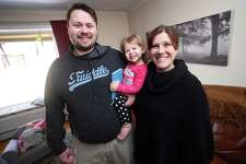Jim and Katie McGonigal are photographed with their daughter, Althea, 18 months, at their home in Woodbridge on March 19, 2018.