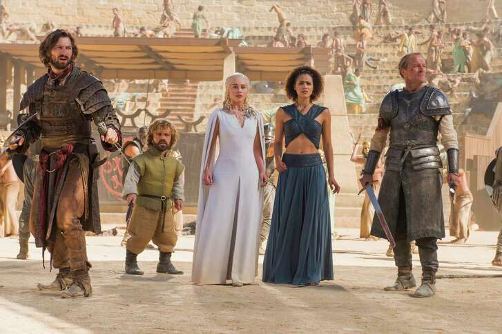 "Michiel Huisman, from left, Peter Dinklage, Emilia Clarke, Nathalie Emmanuel and Iain Glen star in ""Game of Thrones."""
