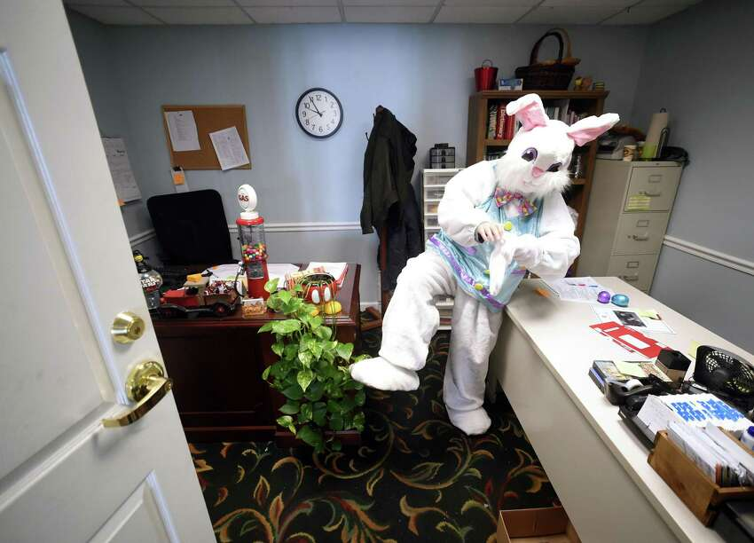 Karen Cohn of Hamden finishes putting on her Easter bunny costume in preparation for an Easter egg hunt at Atria Larson Place in Hamden on March 24, 2018.