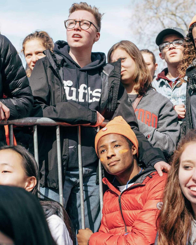 Student organizers embrace while watching Brandi Carlile perform