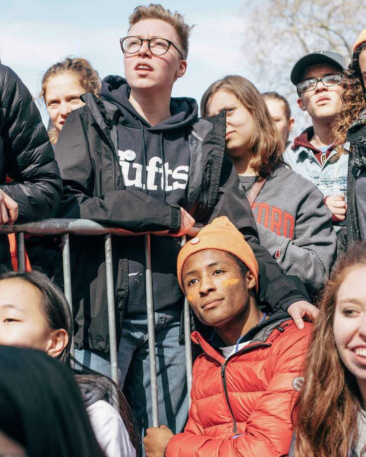 "Student organizers embrace while watching Brandi Carlile perform ""I Feel a Change Comin' On"" by Bob Dylan during the ""March for Our Lives"" demonstration in Seattle on Saturday, March 24, 2018. Photo: GRANT HINDSLEY, SEATTLEPI.COM / SEATTLEPI.COM"