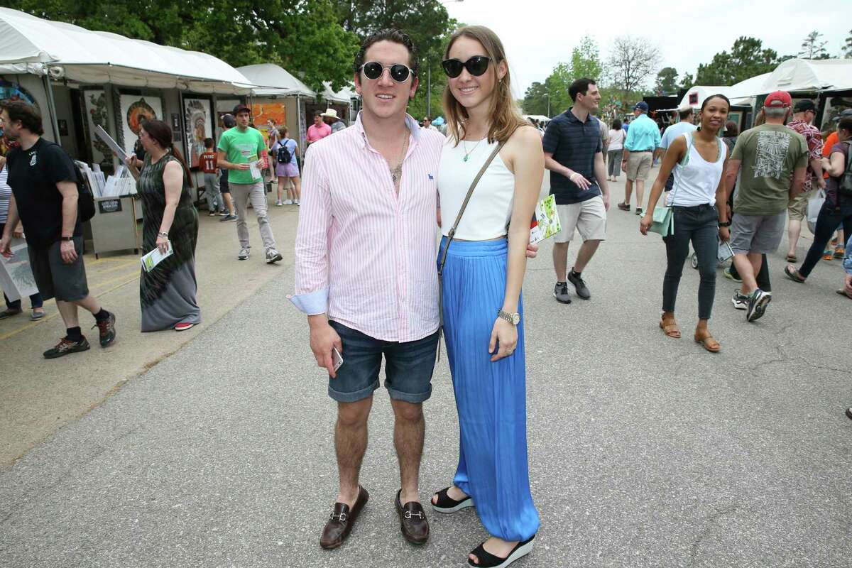 People pose for a photograph at the Bayou City Art Fest at Memorial Park on Saturday, March 24, 2018, in Houston.