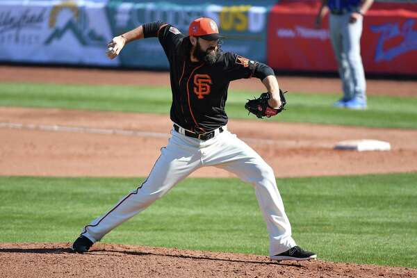Cory Gearrin #26 of the San Francisco Giants delivers a pitch in the spring training game against the Kansas City Royals at Scottsdale Stadium on February 26, 2018 in Scottsdale, Arizona.