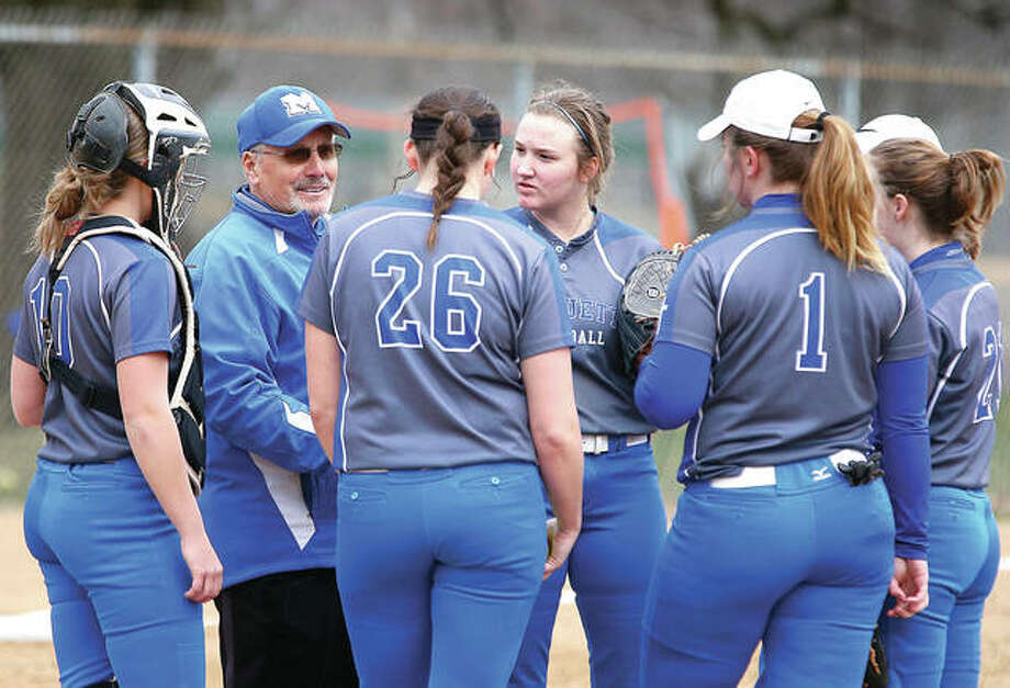 Marquette softball coach Dan Wiedman speaks to his team during Thursday's game against Gillespie at Gordon Moore Park. The Explorers are off to a 4-0 start.
