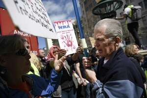 NRA supporter Don Grundmann argues with protesters at the March for Our Lives rally at Frank Ogawa Plaza in Oakland.