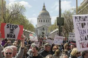 San Francisco demonstrators head toward Market Street, which was closed to traffic for the March for Our Lives rally to support gun control.