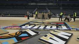 The floor for the official court of the 2018 NCAA Men's Final Four is installed Friday March 23, 2018 in the Alamodome in San Antonio, Texas. Connor Sports is the official court provider of the NCAA since 2006. The 2018 Men's Final Four official court is a trademarked custom built floor called QuickLock and is manufactured from northern hard maple timber from forests in Michigan. The court is 70 feet by 140 feet and is made by using 397 4-foot by 7-foot panels each weighing 188 pounds.