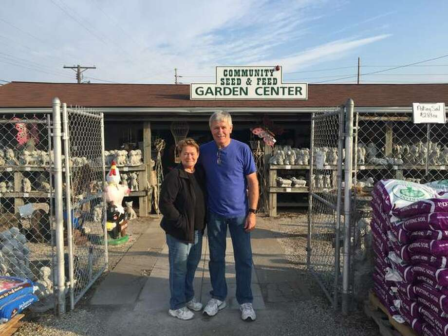 Community Seed & Feed owners Kathy and Herb Ralston stand in front of the business that's been in Herb Ralston's family for most of its century of existence. The East Alton staple is celebrating its 100th anniversary in 2018. Photo: Nathan Grimm | The Telegraph