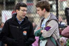 "Washington Attorney General Bob Ferguson speaks with march Shorecrest High Schoo student Asher Maria during the ""March for Our Lives"" demonstration at Cal Anderson Park, Saturday, March 24, 2018. Hundreds of thousands marched in demonstrations across the country in support of gun legislation. Seattle protesters walked from Cal Anderson to the Seattle Center."