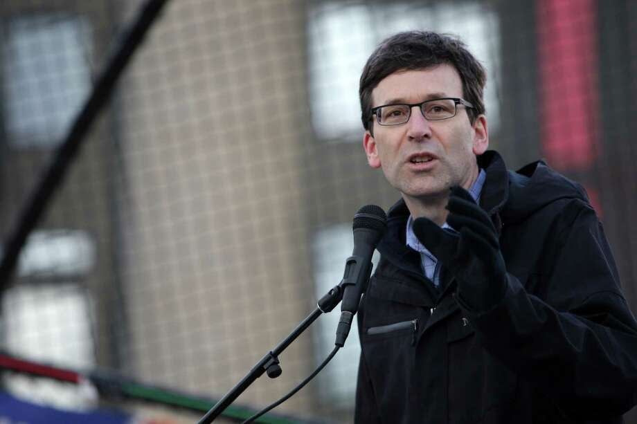 "Washington Attorney General Bob Ferguson speaks to crowds during the ""March for Our Lives"" demonstration at Cal Anderson Park, Saturday, March 24, 2018. Hundreds of thousands marched in demonstrations across the country in support of gun legislation. Seattle protesters walked from Cal Anderson to the Seattle Center. Ferguson has entered another fray, cutting a TV spot calling for passage of Initiative 1631, which would impose a carbon fee on major polluters.  Photo: GENNA MARTIN, SEATTLEPI.COM / Other"