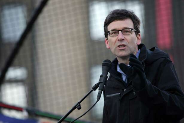 "Washington Attorney General Bob Ferguson speaks to crowds during the ""March for Our Lives"" demonstration at Cal Anderson Park, Saturday, March 24, 2018. Hundreds of thousands marched in demonstrations across the country in support of gun legislation. Seattle protesters walked from Cal Anderson to the Seattle Center."
