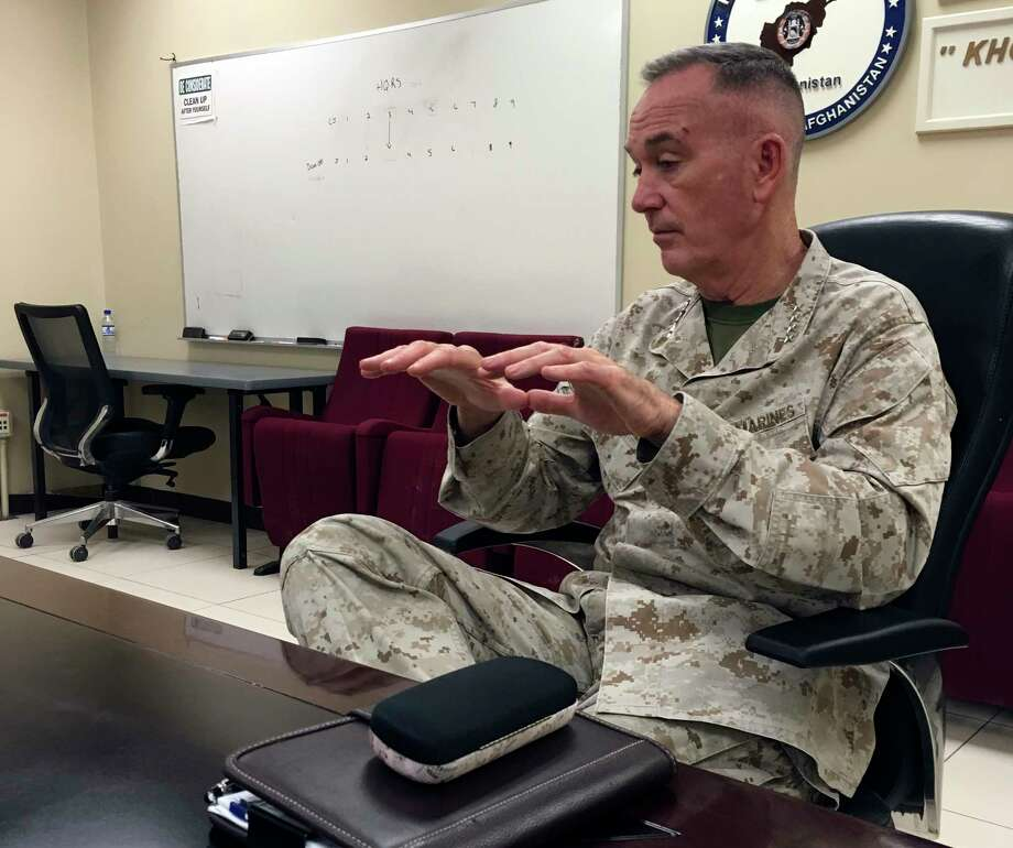 Marine Gen. Joseph Dunford, chairman of the Joint Chiefs of Staff, speaks to the media at Bagram Air Base in Afghanistan on March 21, 2018. Dunford says he's optimistic about Afghanistan after visiting the country this week. (AP Photo?Lolita Baldor) Photo: Lolita Baldor / AP