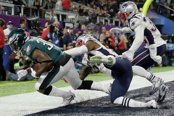 Under a proposed rule change, this touchdown catch by the Eagles' Corey Clement, left, in February's Super Bowl victory over the Patriots probably would have drawn less scrutiny from game officials.
