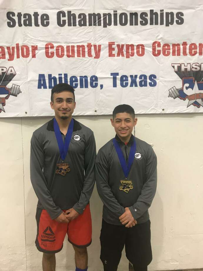 United South senior Oscar Martel, right, won the state championship in the 114-pound weight class Saturday while his classmate Jose Alcorta represented the Panthers with a fifth-place finish in the 132-pound weight class. Photo: Courtesy Photo
