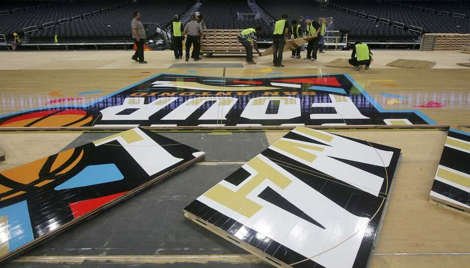 The floor for the official court of the 2018 NCAA Men's Final Four is installed Friday March 23, 2018 in the Alamodome in San Antonio, Texas. Connor Sports is the official court provider of the NCAA since 2006. The 2018 Men's Final Four official court is a trademarked custom built floor called QuickLock and is manufactured from northern hard maple timber from forests in Michigan. The court is 70 feet by 140 feet and is made by using 397 4-foot by 7-foot panels each weighing 188 pounds. Photo: John Davenport, STAFF / San Antonio Express-News / ©John Davenport/San Antonio Express-News