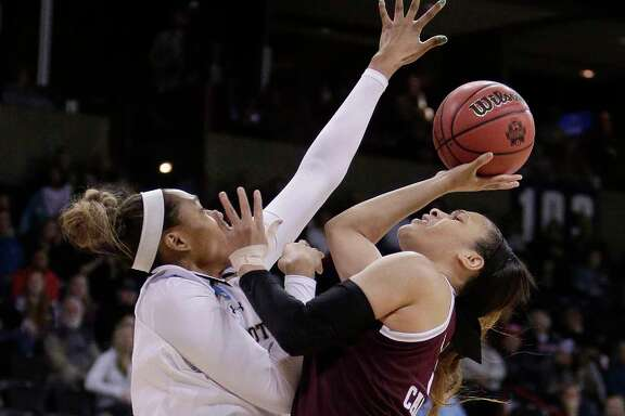 Texas A&M guard Chennedy Carter, right, who finished with 31 points and seven assists, attempts a one-handed shot against Notre Dame's Kristina Nelson during the first half Saturday.