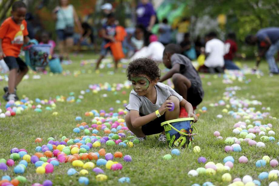 Joseph Diaz, 5, gathers Easter eggs after a helicopter dropped eggs during the 2018 Fifth Ward Lyons Avenue Renaissance Festival, on Lyons Avenue, Saturday, March 24, 2018, in Houston. Organizers include Houston City Councilman Jerry Davis and non-profit organization, the Fifth Ward Community Redevelopment Corporation (FWCRC) ( Karen Warren / Houston Chronicle ) Photo: Karen Warren, Staff / Houston Chronicle / © 2018 Houston Chronicle