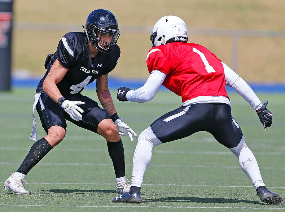 Former Odessa Permian standout and current Tech defensive back Desmon Smith (4) engages a wide receiver in Saturday's spring scrimmage at Grande Communications Stadium. Wade H. Clay/Special to the Reporter-Telegram