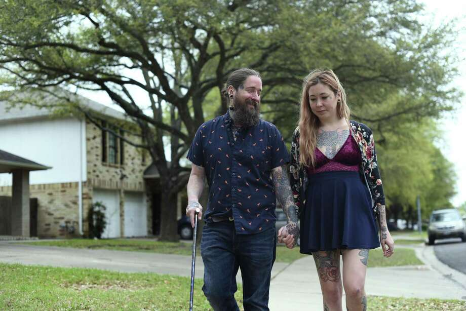 Sean and Rianne Philips live by Anthony Stephan House, 39, who was killed by a package bomb on March 2 in Austin. After hearing the sound of the explosion, Sean Philips attempted to help House, whom he described as bloodied with his clothing ripped. Photo: Billy Calzada, Staff / San Antonio Express-News / San Antonio Express-News
