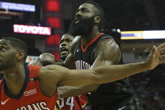 New Orleans Pelicans players Ian Clark (2) and DeAndre Liggins (34) defensing Houston Rockets guard James Harden (13) for a pass during the first quarter of the NBA game at Toyota Center on Saturday, March 24, 2018, in Houston. ( Yi-Chin Lee / Houston Chronicle )