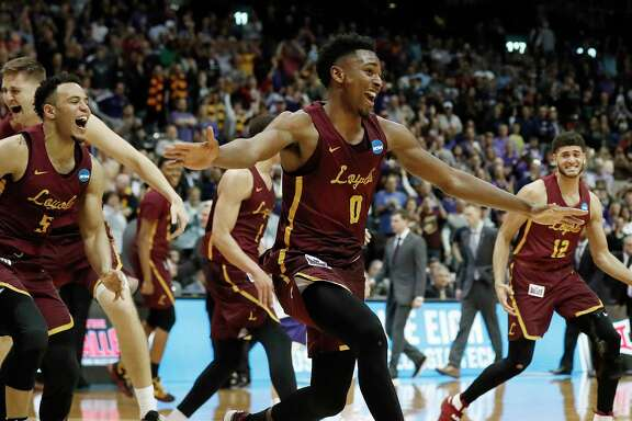The Loyola Ramblers were all smiles after defeating Kansas State on Saturday night to reach the Final Four for the first time since winning the 1963 national title.
