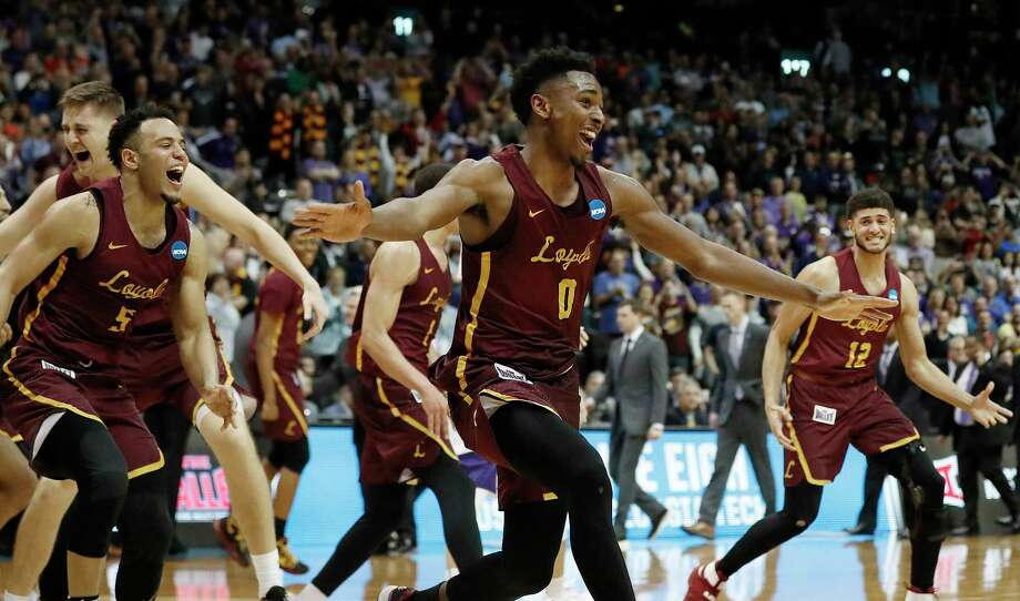 The Loyola Ramblers were all smiles after defeating Kansas State on Saturday night to reach the program's first Final Four since its 1963 national championship. Photo: David Goldman, STF / Copyright 2018 The Associated Press. All rights reserved.