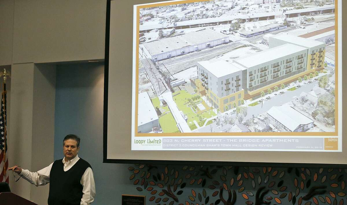 """Xavier Gonzalez, Director of Design GRG Architecture speaks on the proposed Bridge Apartments to be built next to the Hays Street Bridge during District 2 Councilman William H. """"Cruz"""" Shaw's Town Hall held Monday Feb. 5, 2018 at the Heritage Room of the Campus Center Building at St. Philip?•s College."""
