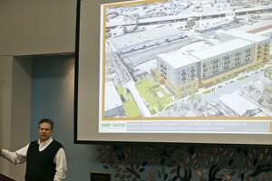 "Xavier Gonzalez, Director of Design GRG Architecture speaks on the proposed Bridge Apartments to be built next to the Hays Street Bridge during District 2 Councilman William H. ""Cruz"" Shaw's Town Hall held Monday Feb. 5, 2018 at the Heritage Room of the Campus Center Building at St. PhilipÕs College."