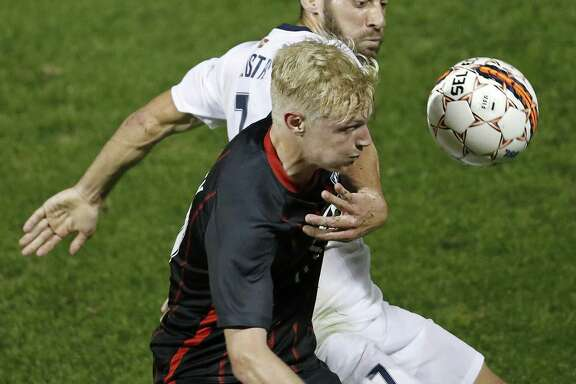 San Antonio FC's Connor Presley and Saint Louis FCÕs Joey Calistri go after the ball during first half action Saturday March 24, 2018 at Toyota Field.