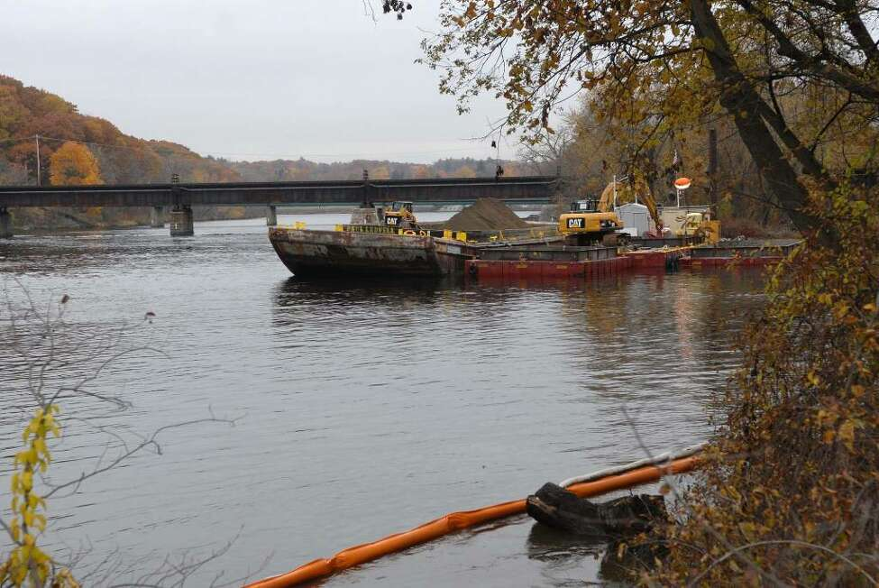 Dredging the Hudson River for PCBs is over for the season but some backfill operations will continue for several weeks in the Fort Edward area as work slows Tuesday. (Paul Buckowski/Times Union)