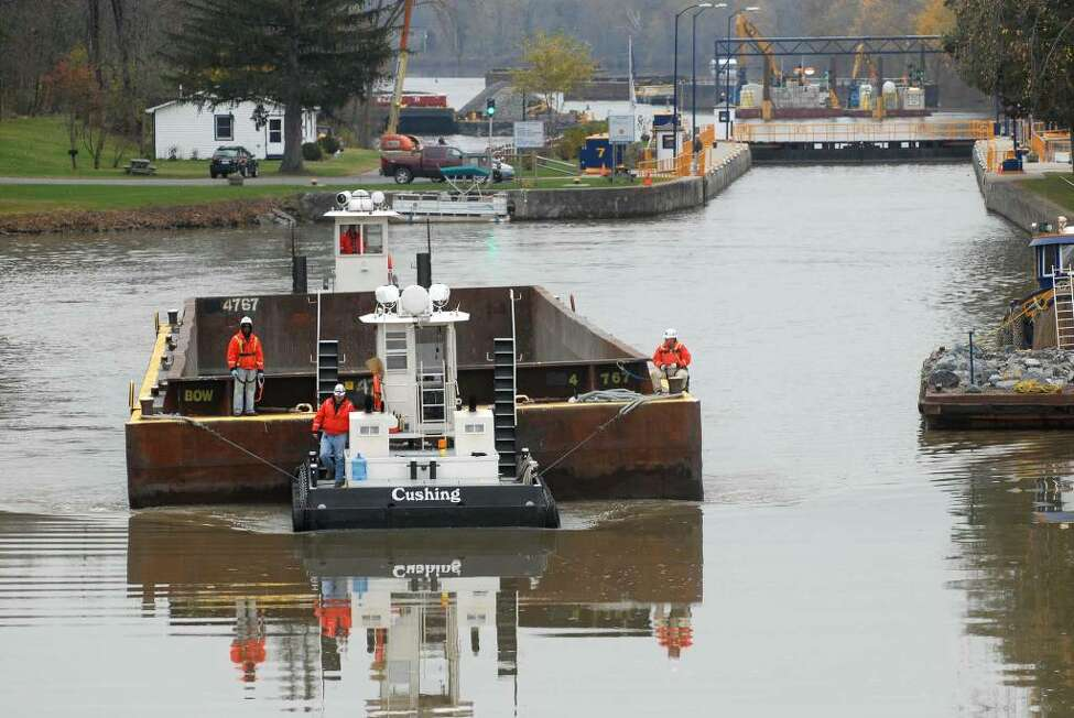 Dredging operations on the Hudson River in Fort Edward slow Tuesday as workers backfill areas that had been cleared of sediment containing PCBs. (Paul Buckowski/Times Union)
