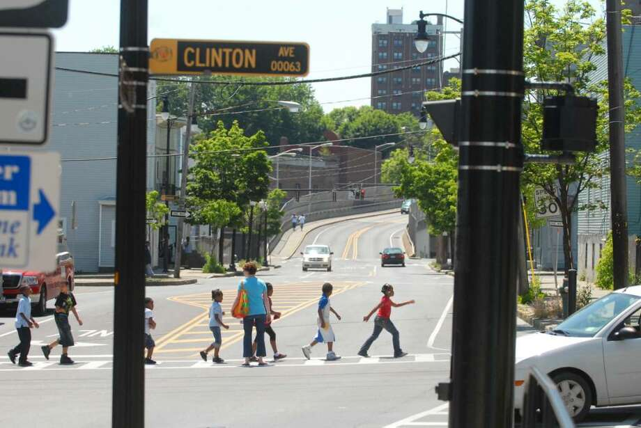 A group of school children cross Henry Johnson Blvd. at the intersection with Clinton Ave.  in Albany.   (Paul Buckowski / Times Union) Photo: PAUL BUCKOWSKI / 10008891A