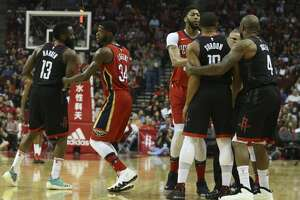 Houston Rockets and New Orleans Pelicans players try to separate Houston Rockets's Eric Gordon (10) and New Orleans Pelicans' E'Twaun Moore (55) during a altercation in the third quarter of the NBA game at Toyota Center on Saturday, March 24, 2018, in Houston. ( Yi-Chin Lee / Houston Chronicle )