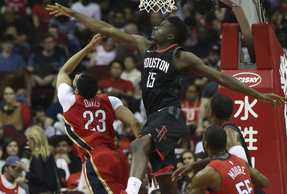 Houston Rockets center Clint Capela (15) blocks New Orleans Pelicans forward Anthony Davis (23) during the second quarter of the NBA game at Toyota Center on Saturday, March 24, 2018, in Houston. ( Yi-Chin Lee / Houston Chronicle ) Photo: Yi-Chin Lee/Houston Chronicle