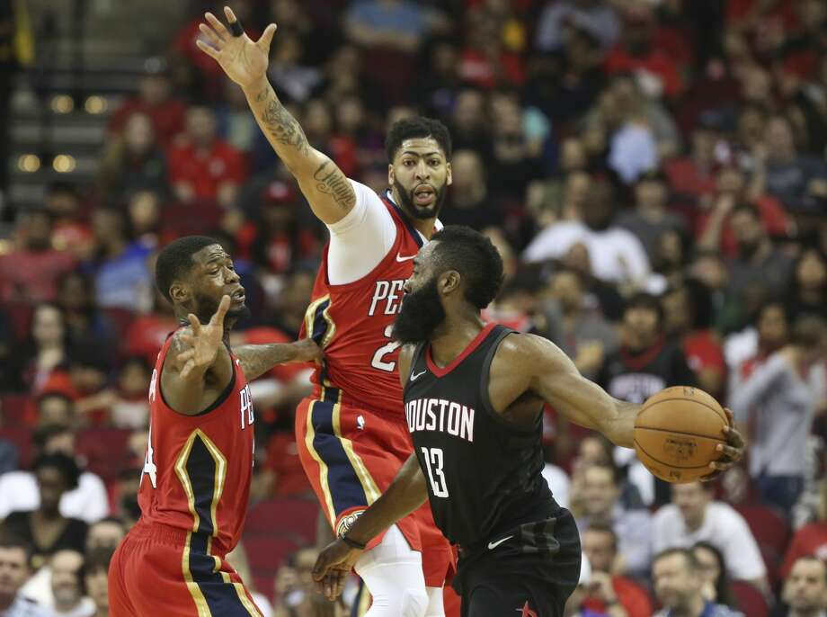 New Orleans Pelicans players DeAndre Liggins (34) and Anthony Davis (23) try to stop Houston Rockets guard James Harden (13) passing through them during the third quarter of the NBA game at Toyota Center on Saturday, March 24, 2018, in Houston. ( Yi-Chin Lee / Houston Chronicle ) Photo: Yi-Chin Lee/Houston Chronicle
