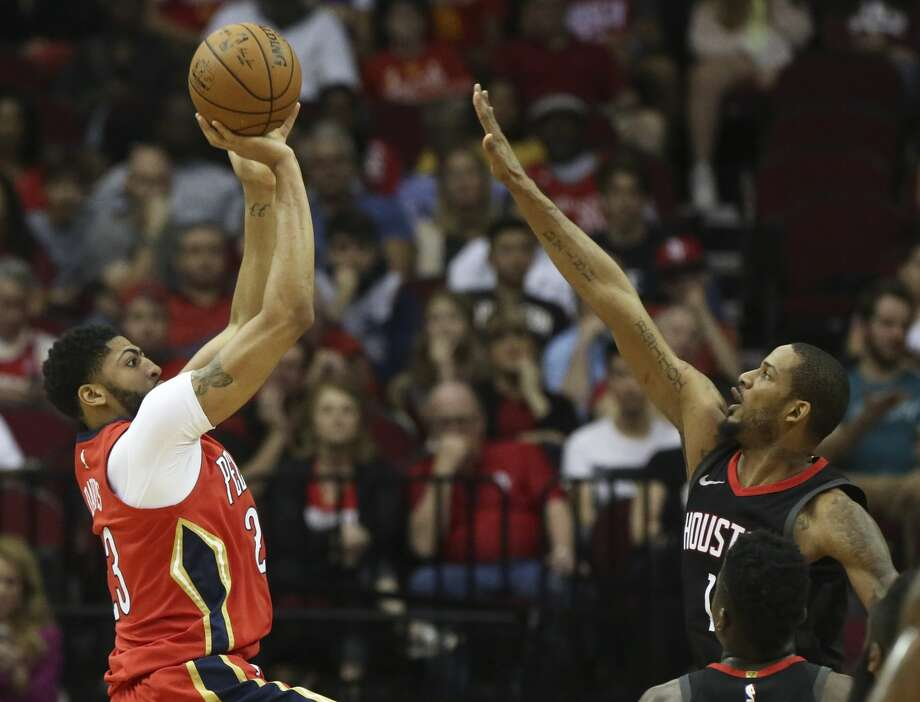 Houston Rockets forward Trevor Ariza (1) tries to stop New Orleans Pelicans forward Anthony Davis (23) from shooting for the hoop during the first quarter of the NBA game at Toyota Center on Saturday, March 24, 2018, in Houston. ( Yi-Chin Lee / Houston Chronicle ) Photo: Yi-Chin Lee/Houston Chronicle