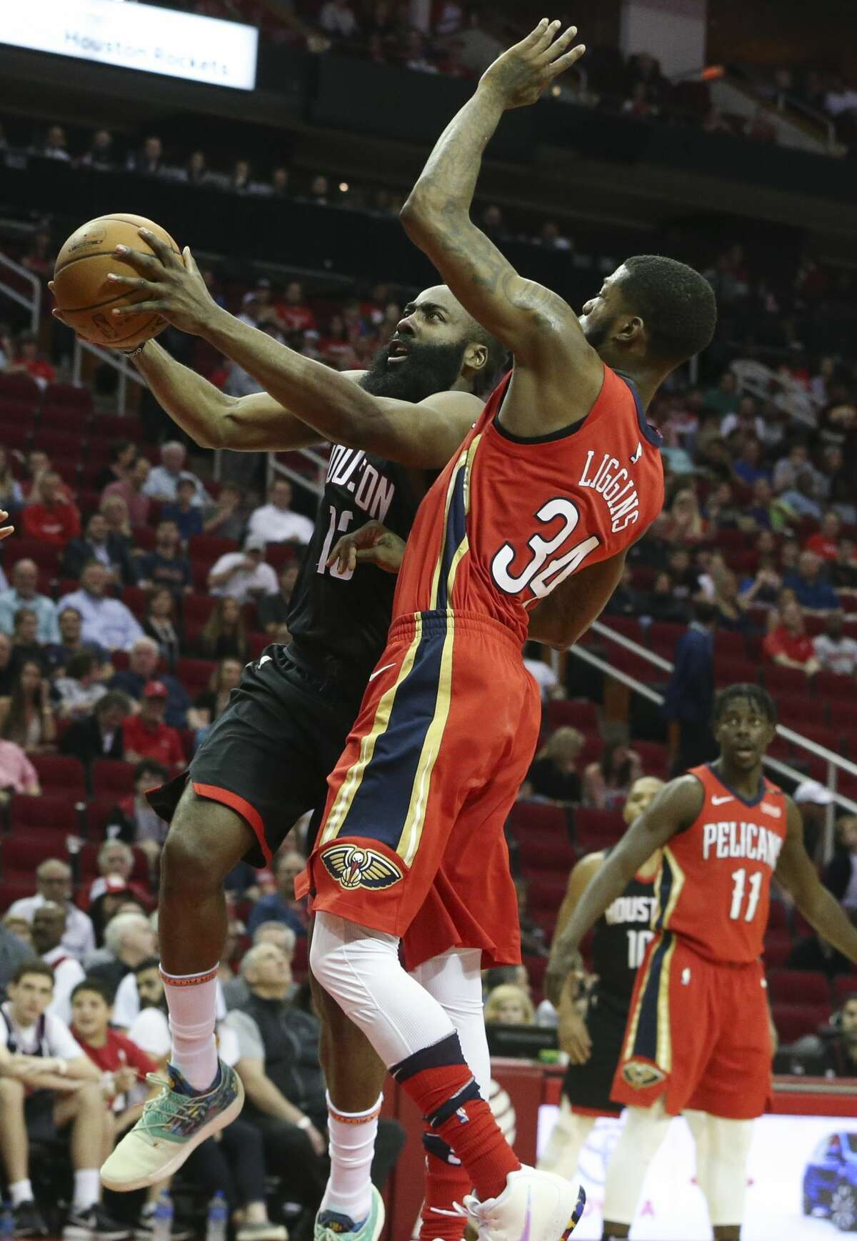 Houston Rockets guard James Harden (13) passes New Orleans Pelicans guard DeAndre Liggins (34) for a lay up during the first quarter of the NBA game at Toyota Center on Saturday, March 24, 2018, in Houston. ( Yi-Chin Lee / Houston Chronicle )