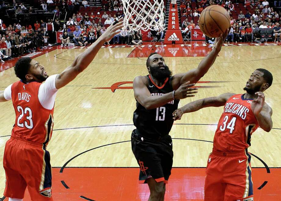 Houston Rockets guard James Harden (13) drives to the basket as New Orleans Pelicans forward Anthony Davis (23) and guard DeAndre Liggins (34) defend during the first half of an NBA basketball game Saturday, March 24, 2018, in Houston. (AP Photo/Eric Christian Smith) Photo: Eric Christian Smith / FR171023 AP