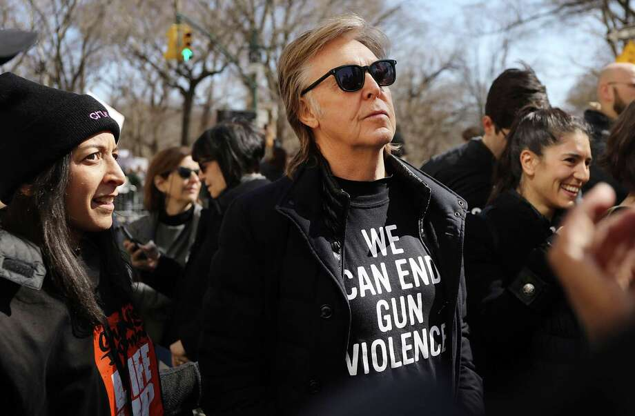 NEW YORK, NY - MARCH 24:  Sir Paul McCartney joins thousands of people, many of them students, march against gun violence in Manhattan during the March for Our Lives rally on March 24, 2018 in New York, United States. More than 800 March for Our Lives events, organized by survivors of the Parkland, Florida school shooting on February 14 that left 17 dead, are taking place around the world to call for legislative action to address school safety and gun violence.  (Photo by Spencer Platt/Getty Images) *** BESTPIX *** Photo: Spencer Platt / 2018 Getty Images